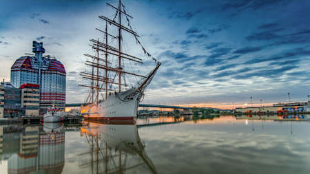 A cool looking white boat in the port Stock Photo