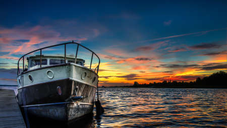 ruder: A beautiful landscape at sunset and a boat