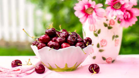 A bowl full of cherries Stock Photo
