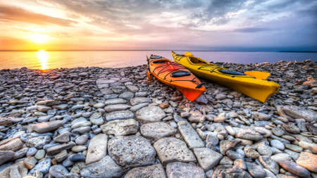 2 kayaks on a rocky beach