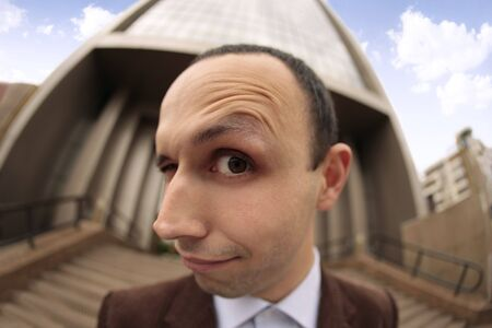 close up with a fish eye of a mans face with the eyebrow raised