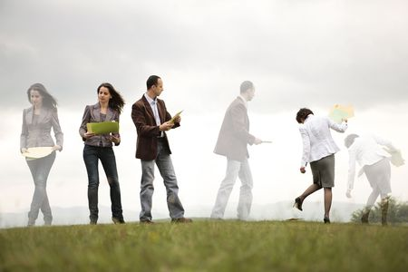 business people on a hill organizing and looking for files Stock Photo