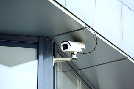 electronically: survillance camera outside an office building