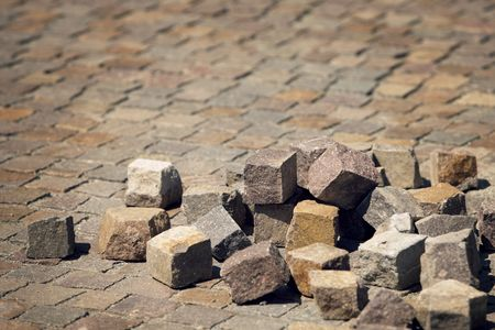 cubic rocks in random order over a pavement made from the same Stock Photo - 3537963