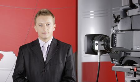 presenter in front of the camera in a TV studio photo