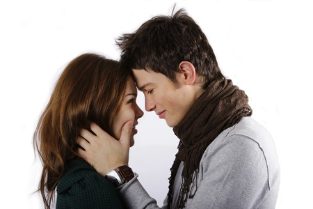 attractive couple face to face looking into each others eyes isolated on white Stock Photo - 4171047