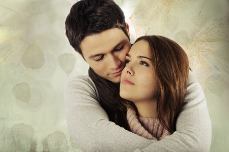 young attractive couple holding against green textured background with leafs