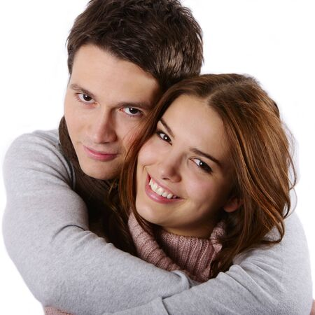 Young attractive couple passionately in love holding isolated on white