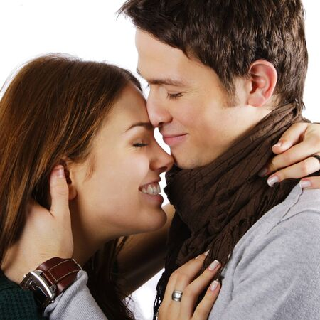 Young attractive couple passionately in love hugging and laughing isolated on white