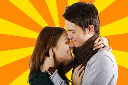 passionately: Young attractive couple passionately in love hugging and laughing on ray of colors