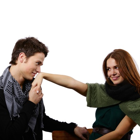 mesmerized: handsome boy kissing a beautiful girls hand