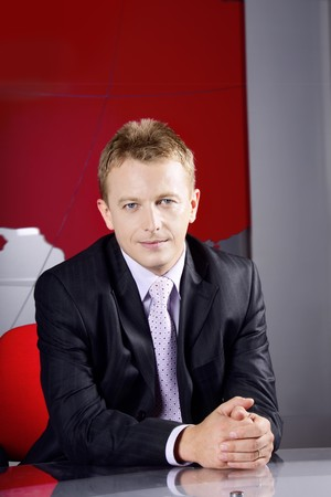 presenter: news presenter and businessman working at the studio, office looking at the camera Stock Photo