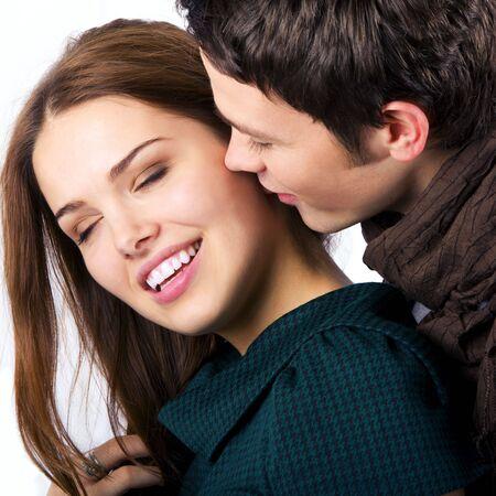 faire l amour: pr�s de attractive couple passionn�ment forplay isol� sur fond blanc Banque d'images