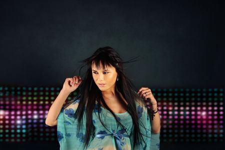 Portrait of beautiful brunet girl dancing in the night club Stock Photo