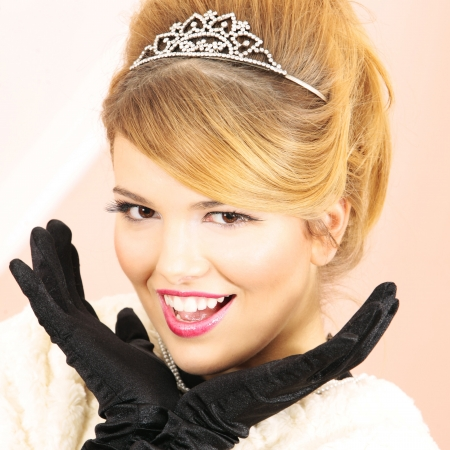 Prom Queen smiling excited looking at the camera with hands next to her pretty face Stock Photo - 6353505