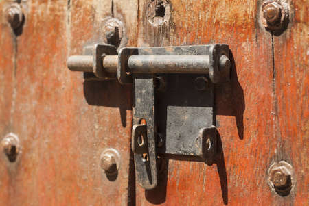 hasp: Vintage stylized old metal hasp on old vintage wooden door
