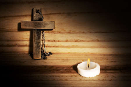 cross in wood, candle