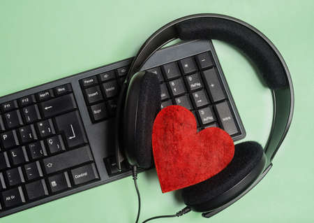 keyboard with headphones with a red heart Banco de Imagens