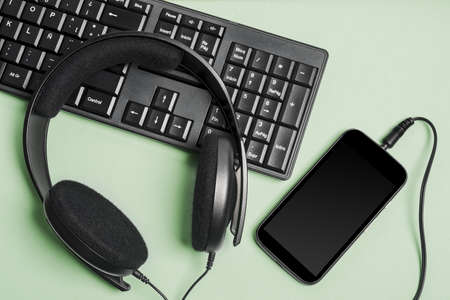 keyboard black with headphones and smart telephone Banco de Imagens