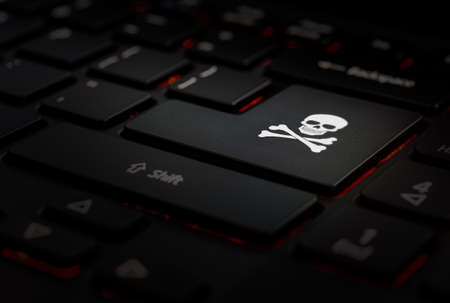 black keyboard with key hacker, skull.
