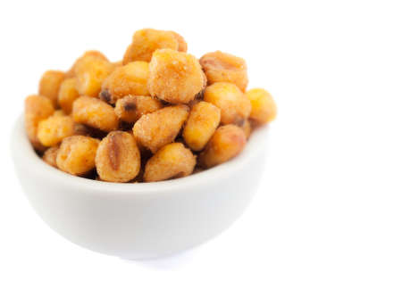 fried corn in bowl on white background