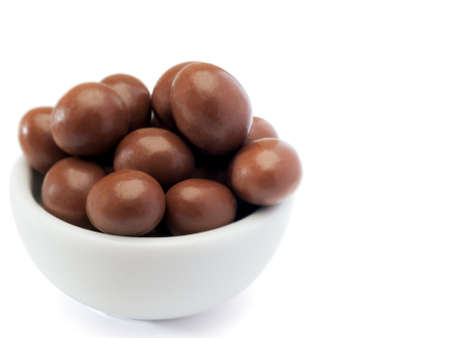 hazelnuts chocolate in bowl, white background Banco de Imagens
