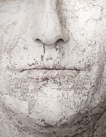 Face with broken clay, dry skin