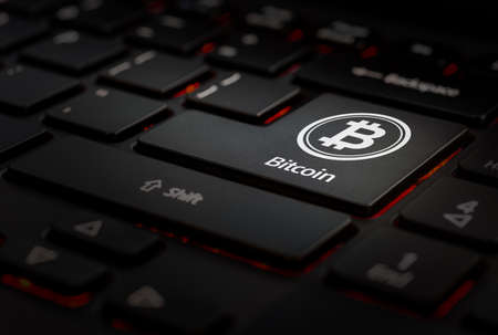 Black keyboard with icon bitcoin