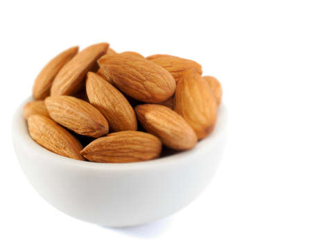 almonds in bowl, background white