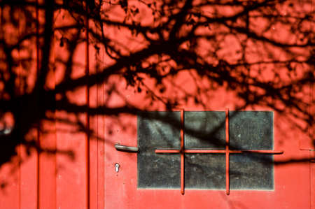 red door: Red door with shadow Stock Photo