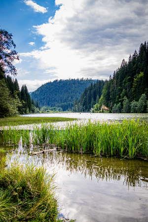 Red Lake (also known as Lake GhilcoÅŸ) is a natural dam lake in Harghita County, Romania Foto de archivo - 150109254
