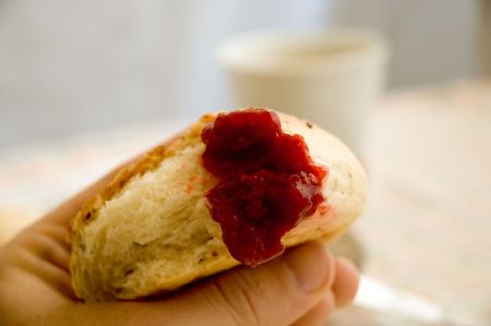 Some strawberry jar on bread at breakfast time.