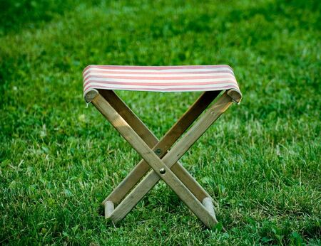 An X shaped seat on the lawn