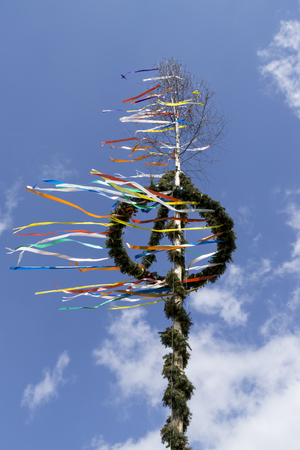 typical maypole in front of sky