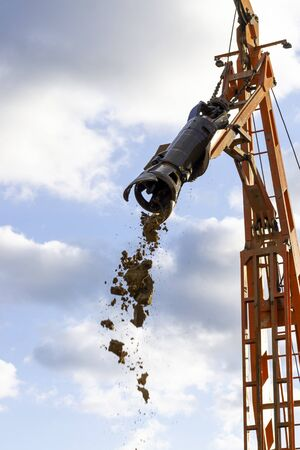 Ground water hole drilling machine installed on a truck. Groundwater well drilling. Stock Photo