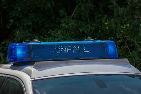 Close-up of a roof beam or roof bar on a police car with the inscription Unfall in German, which means accident Banco de Imagens