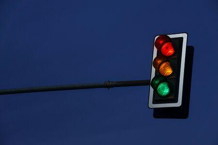 Closeup of a traffic light by night