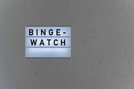 Top view lightbox with the message Binge-Watch Standard-Bild