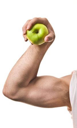 masculin: Very strong masculin hand holding tight a green apple