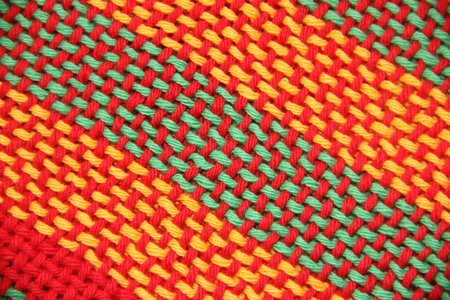 colorful knitted garments and blankets, comb loom