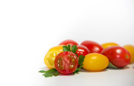 red and yellow cherry tomatoes on white background Banque d'images