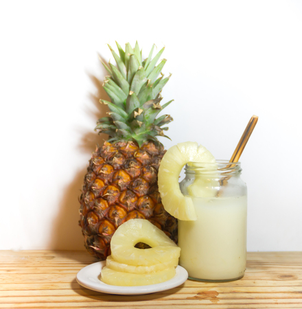 glasses with juice pineapple drinks and smoothies fresh pineapple Stock Photo