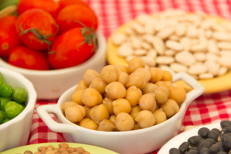 variety of kitchen ingredients with fresh and dried legumes Stock Photo