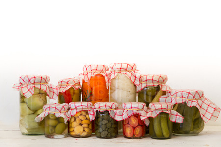 variety of jars with organic vegetable pickles