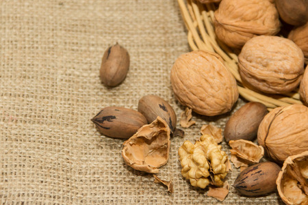 variety of healthy nuts on rustic background