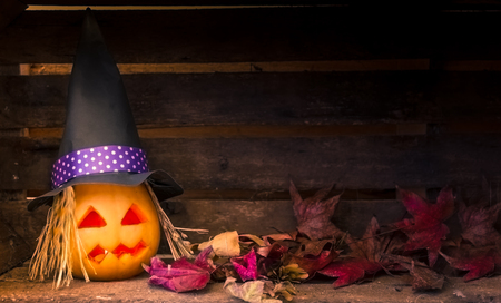 original decorations with pumpkins and halloween witch hats