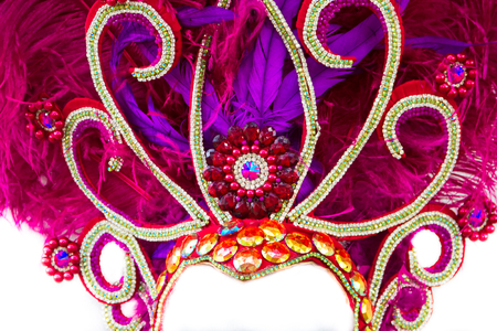 helmet decorated with bright stones and feathers for carnival