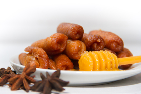 pestiños with port and honey typical of Spanish gastronomy