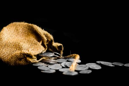 sack with the thirty silver coins biblical symbol of the betrayal of judas Stock Photo