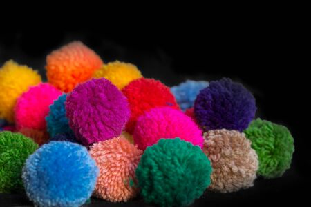 textured background of assorted and multicolored wool pom poms Stock Photo